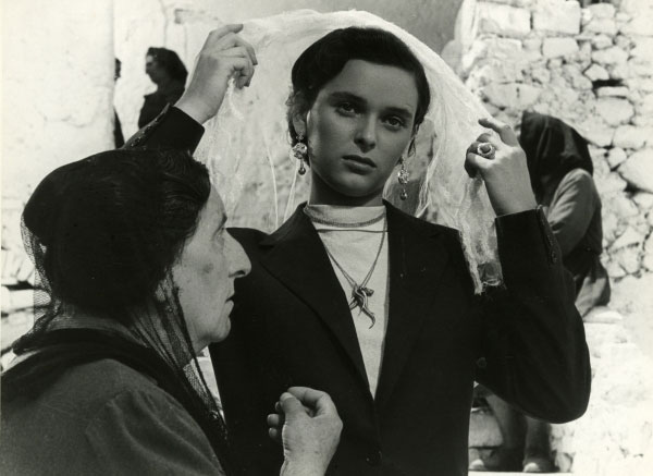Lucia Lucia Bose Pulls At Her Veil While An Older Woman