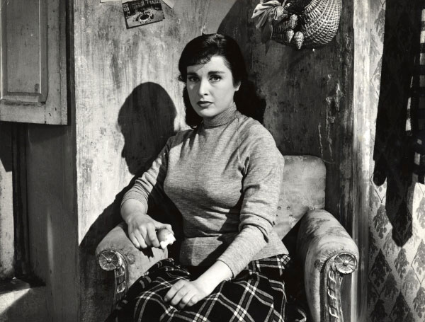 Silvana Pampanini Anna Sits In A Chair Holding A Half