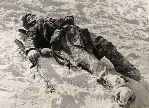 Dead Soldier Covered In Snow Laying In The Snow